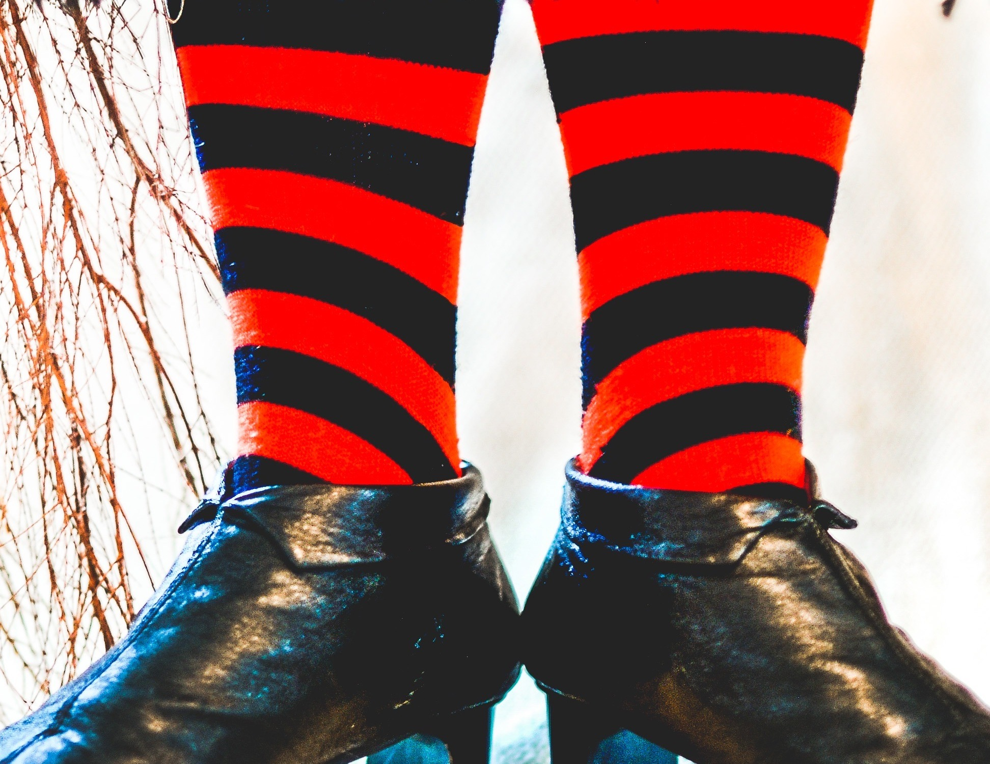 Image of black shoes and striped stockings